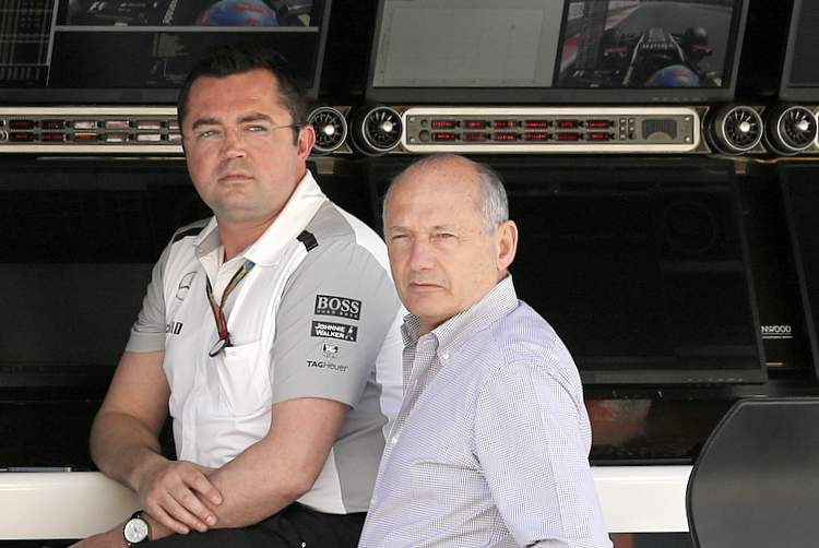 Eric Boullier and Ron Dennis in the pits.