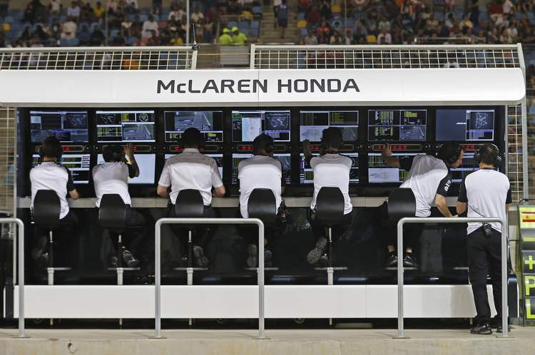 The McLaren-Honda engineers on the pit wall.