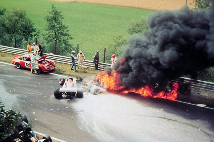 The spectacular crash of World Champion Niki Lauda in todays West German Grand Prix here. After colliding with other cars Lauda's Ferrari caught fire. Niki Lauda was rushed to hospital