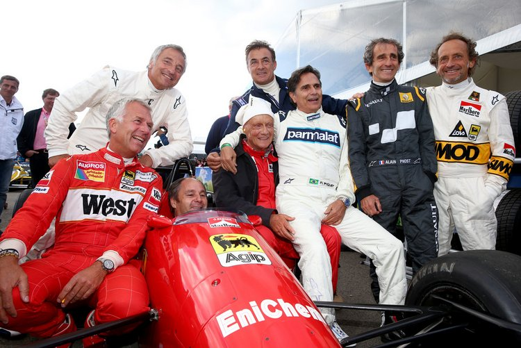 Christian Danner, Riccardo Patrese, Gerhard Berger, Niki Lauda, Jean Alesi, Nelson Piquet, Pierluigi Martini and Alain Prost pose on track after qualifying for the Formula One Grand Prix of Austria at Red Bull Ring on June 20, 2015 in Spielberg, Austria.