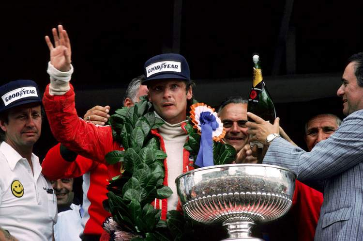 Niki Lauda (AUT) (Centre) celebrates on the podium his first victory since his near-fatal accident at the Nurburgring the previous season. South African Grand Prix, Rd 3, Kyalami, South Africa, 5 March 1977. BEST IMAGE
