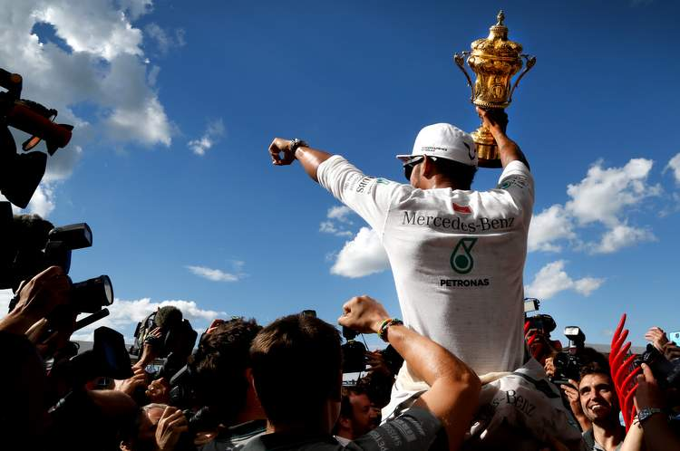 Race winner Lewis Hamilton (GBR) Mercedes AMG F1 celebrates with the trophy. Formula One World Championship, Rd9, British Grand Prix, Race Day, Silverstone, England, Sunday 6 July 2014.