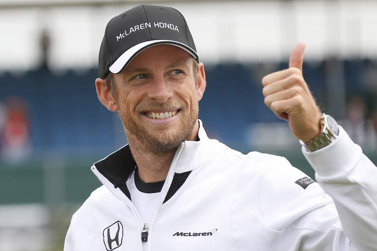 Jenson Button give a thumbs up.
