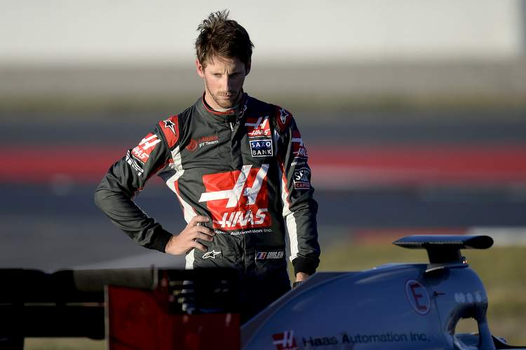 HAAS F1 Team's French driver Romain Grosjean stands beside his car after stopping at the Circuit de Catalunya on March 3, 2016 in Montmelo on the outskirts of Barcelona during the third day of the second week of tests for the Formula One Grand Prix season. / AFP / JOSEP LAGO