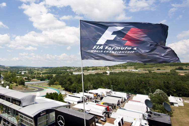 BUDAPEST, HUNGARY - JULY 24: The FIA flag flaps in the wind above the paddock during previews ahead of the Hungarian Formula One Grand Prix at Hungaroring on July 24, 2014 in Budapest, Hungary. (Photo by Drew Gibson/Getty Images)