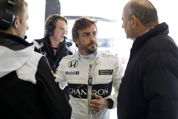 Fernando Alonso with Ron Dennis in the garage.
