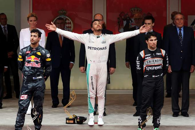 Lewis Hamilton of Great Britain and Mercedes GP celebrates on the podium with Daniel Ricciardo of Australia and Red Bull Racing and Sergio Perez of Mexico and Force India-001