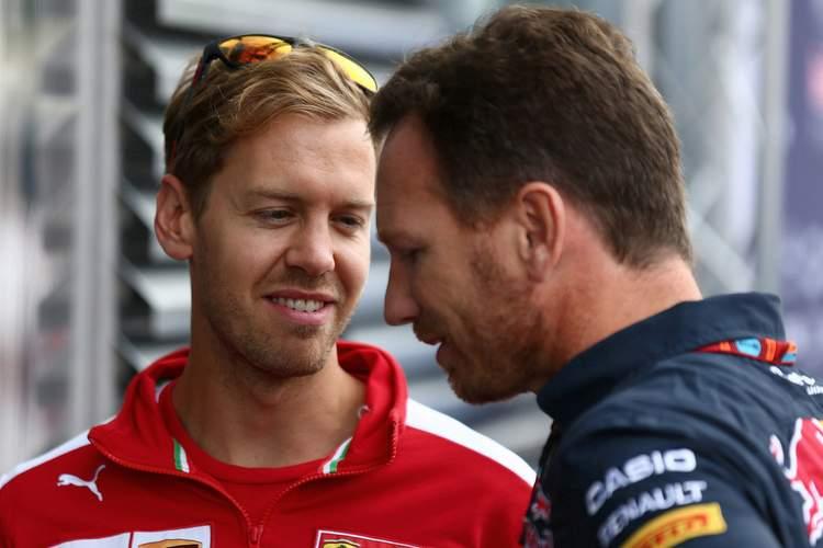 04.09.2015 - Free Practice 1, Sebastian Vettel (GER) Scuderia Ferrari SF15-T and Christian Horner (GBR), Red Bull Racing, Sporting Director