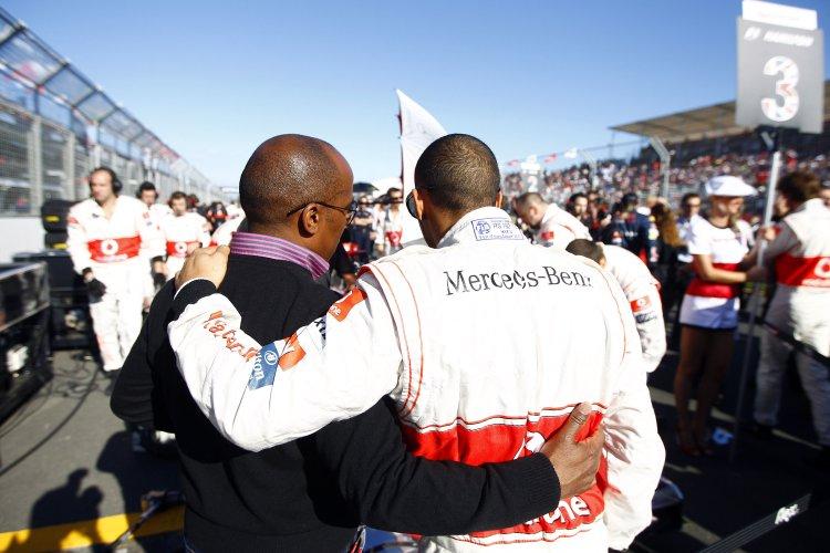 Lewis and Anthony Hamilton walk the pitlane
