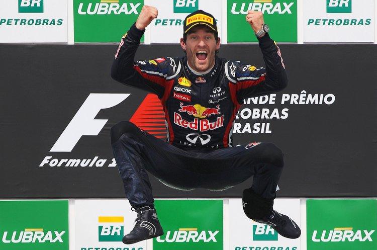 Mark Webber celebrates on the podium Formula 1