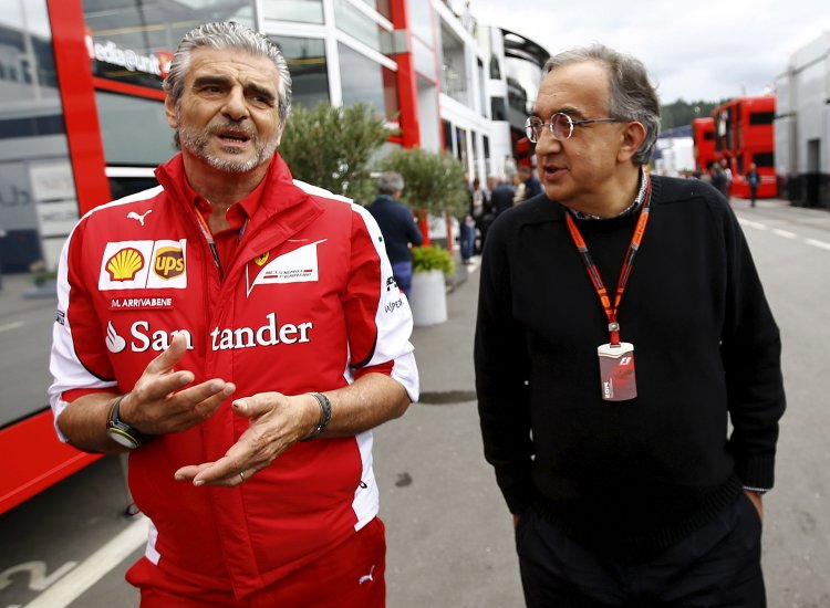 Ferrari Formula One team leader Maurizio Arrivabene (L) and Sergio Marchionne, CEO of Fiat Chrysler automobil arrive in the paddock before the start of the Austrian F1 Grand Prix at the Red Bull Ring circuit in Spielberg, Austria, June 21, 2015. REUTERS/Leonhard Foeger - RTX1HG4Q