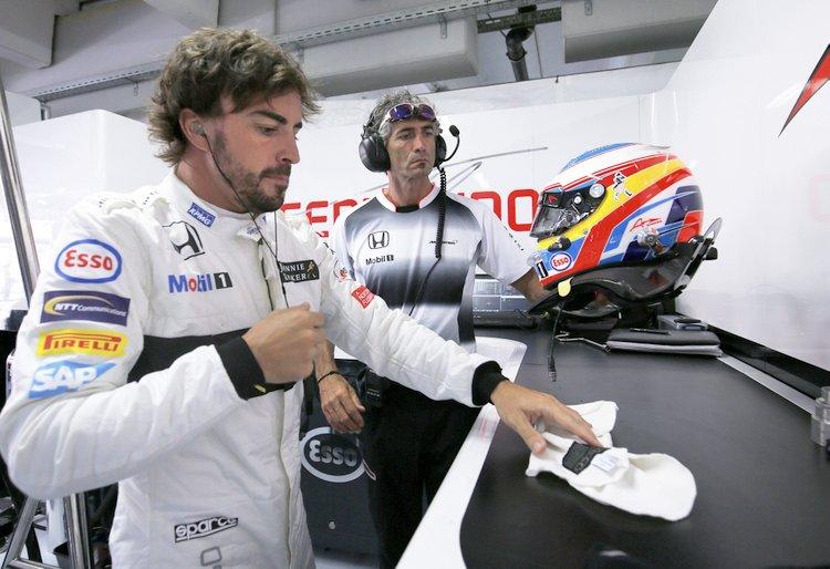 Fernando Alonso prepares his balaclava in the garage