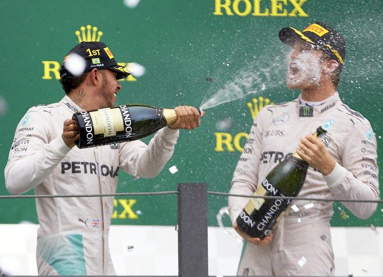Hamilton Rosberg celebrate podium champagne spray