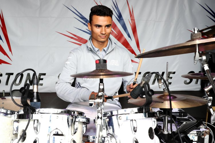 Pascal Wehrlein (GER) Manor Racing play drums on the Silverstone stage. 09.07.2016. Formula 1 World Championship, Rd 10, British Grand Prix, Silverstone, England, Qualifying Day.