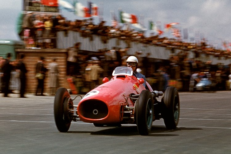 The British Grand Prix; Silverstone, July 18, 1953. Giuseppe Farina passes the pits with his Ferrari 500/F2. He would finish third. (Photo by Klemantaski Collection/Getty Images)