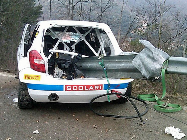 """In this photo taken Sunday, Feb. 6, 2011, a piece of guard rail through the wrecked Skoda car of Polish Formula One driver Robert Kubica after a crash during the rally """"Ronde di Andora"""" in Andora, Italy. Kubica was brought out of an induced coma Monday, Feb. 7, 2011 and was reported to be in a stable condition after suffering serious injuries in a rally car crash. However, the 26-year-old Polish driver will likely need further surgery to his elbow and shoulder, his Lotus Renault team said. (AP Photo/Gianni Chiaramonti)"""