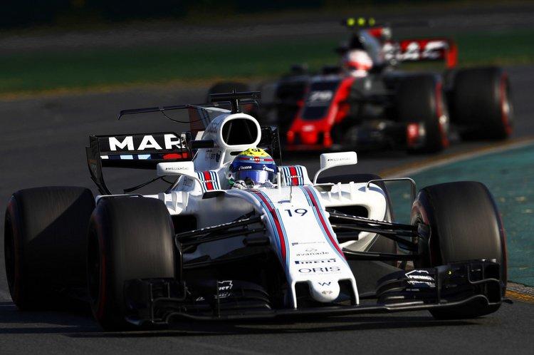 Albert Park, Melbourne, Australia. Sunday 26 March 2017. Felipe Massa, Williams FW40 Mercedes, leads Kevin Magnussen, Haas VF-17 Ferrari. World Copyright: Glenn Dunbar/LAT Images ref: Digital Image _31I2649