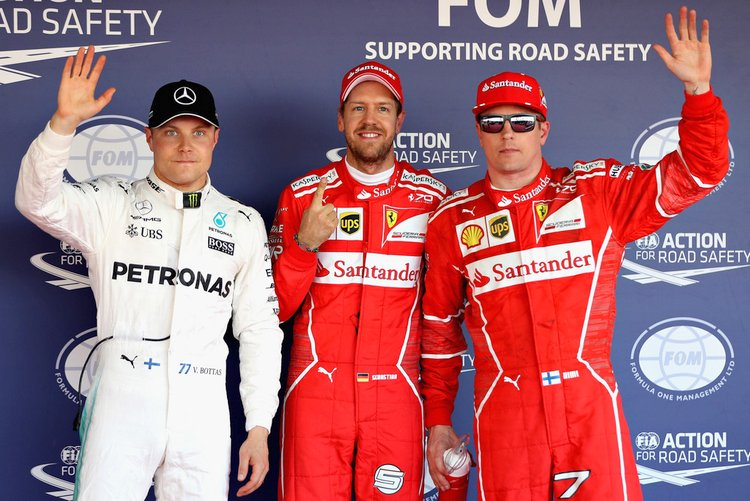 Sebastian Vettel (Ferrari), second placed Kimi Raikkonen (Ferrari) and third placed Valtteri Bottas (Mercedes)