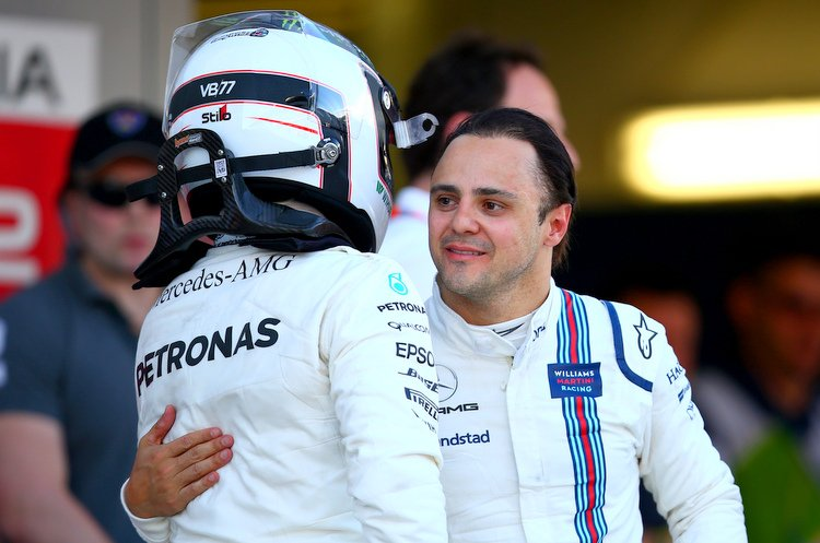SOCHI, RUSSIA - APRIL 30: Race winner Valtteri Bottas of Finland and Mercedes GP is congratulated by Felipe Massa of Brazil and Williams in parc ferme during the Formula One Grand Prix of Russia on April 30, 2017 in Sochi, Russia. (Photo by Dan Istitene/Getty Images)