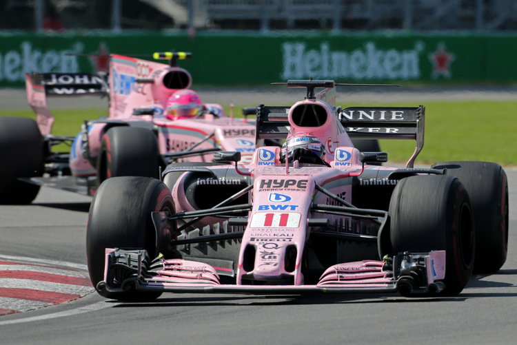 Sergio Perez (MEX) Sahara Force India F1 VJM10 leads team mate Esteban Ocon (FRA) Sahara Force India F1 VJM10.Canadian Grand Prix, Sunday 11th June 2017. Montreal, Canada.