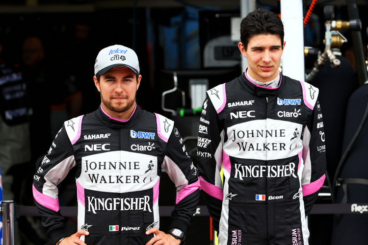 (L to R): Sergio Perez (MEX) Sahara Force India F1 with team mate Esteban Ocon (FRA) Sahara Force India F1 Team.Australian Grand Prix, Friday 24th March 2017. Albert Park, Melbourne, Australia.