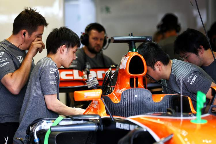 Formula One World Championship 2017, Round 7, Canadian Grand Prix, Montreal, Canada, Friday 9 June 2017 - McLaren MCL32 of Fernando Alonso (ESP) McLaren worked on by mechanics.