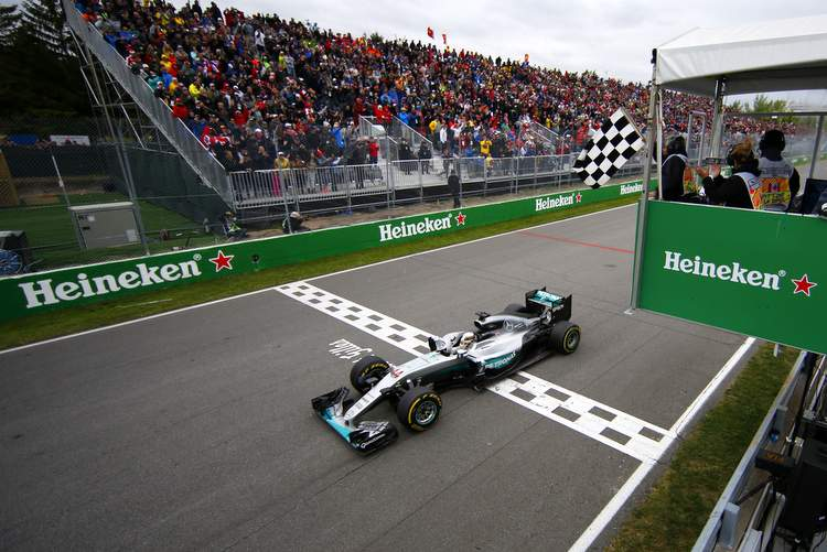 Circuit Gilles Villeneuve, Montreal, Canada. Sunday 12 June 2016. Lewis Hamilton, Mercedes F1 W07 Hybrid crosses the line and takes the chequered flag to win the race. World Copyright: Glenn Dunbar/LAT Photographic ref: Digital Image _W2Q7079