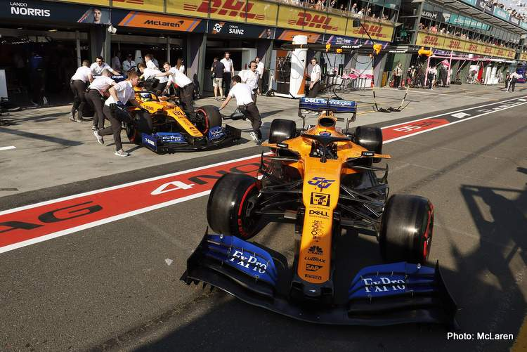 Carlos Sainz Jr., McLaren MCL34, and Lando Norris, McLaren MCL34, in the pits