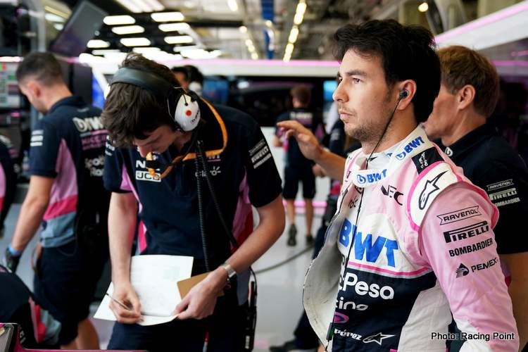 Sergio Perez, Racing Point talks to an enginer in the garage