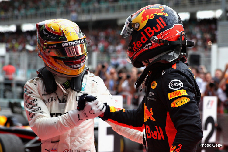KUALA LUMPUR, MALAYSIA - OCTOBER 01: Race winner Max Verstappen of Netherlands and Red Bull Racing is congratulated by Lewis Hamilton of Great Britain and Mercedes GP in parc ferme during the Malaysia Formula One Grand Prix at Sepang Circuit on October 1, 2017 in Kuala Lumpur, Malaysia. (Photo by Will Taylor-Medhurst/Getty Images)