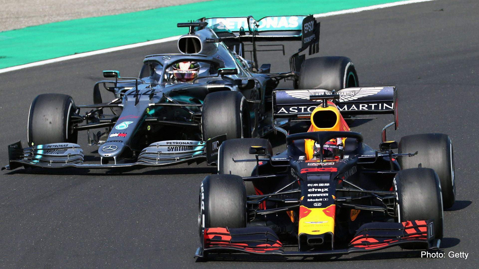 TOPSHOT - Red Bull's Dutch driver Max Verstappen (R) competes next to Mercedes' British driver Lewis Hamilton during the Formula One Hungarian Grand Prix at the Hungaroring circuit in Mogyorod near Budapest, Hungary, on August 4, 2019. (Photo by FERENC ISZA / AFP) (Photo credit should read FERENC ISZA/AFP/Getty Images)
