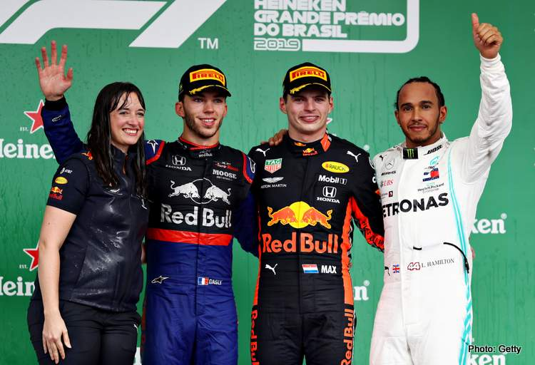 SAO PAULO, BRAZIL - NOVEMBER 17: Top three finishers Max Verstappen of Netherlands and Red Bull Racing, Pierre Gasly of France and Scuderia Toro Rosso and Lewis Hamilton of Great Britain and Mercedes GP celebrate on the podium during the F1 Grand Prix of Brazil at Autodromo Jose Carlos Pace on November 17, 2019 in Sao Paulo, Brazil. (Photo by Mark Thompson/Getty Images) // Getty Images / Red Bull Content Pool // AP-227DM8Q1W2111 // Usage for editorial use only //