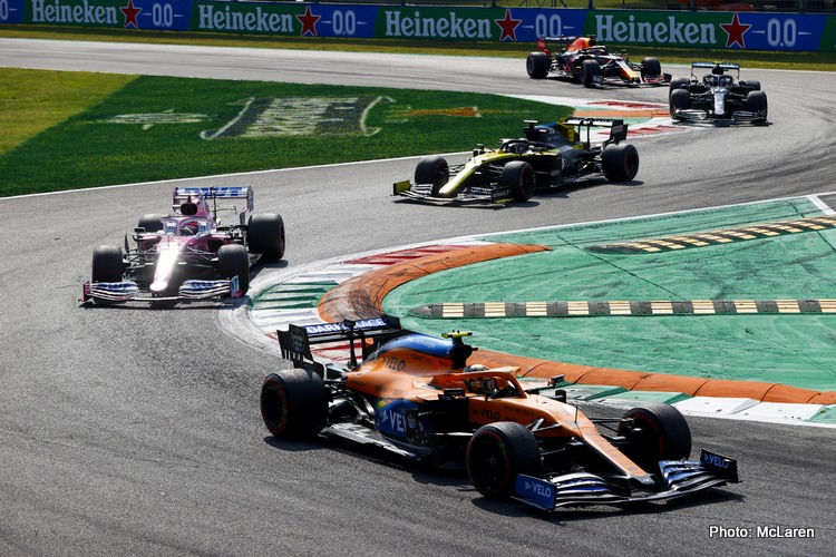 Lando Norris, McLaren MCL35, leads Sergio Perez, Racing Point RP20, and Daniel Ricciardo, Renault R.S.20