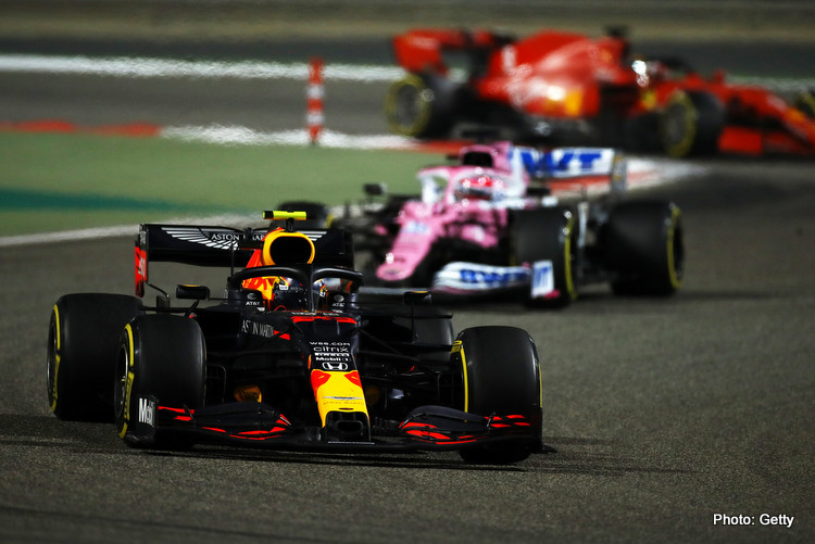 Alexander Albon of Thailand driving the (23) Aston Martin Red Bull Racing RB16 leads Sergio Perez of Mexico driving the (11) Racing Point RP20 Mercedes on track during the F1 Grand Prix of Sakhir at Bahrain International Circuit on December 06, 2020 in Bahrain, Bahrain.