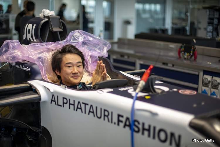 Yuki Tsunoda of Japan completes his seat fit