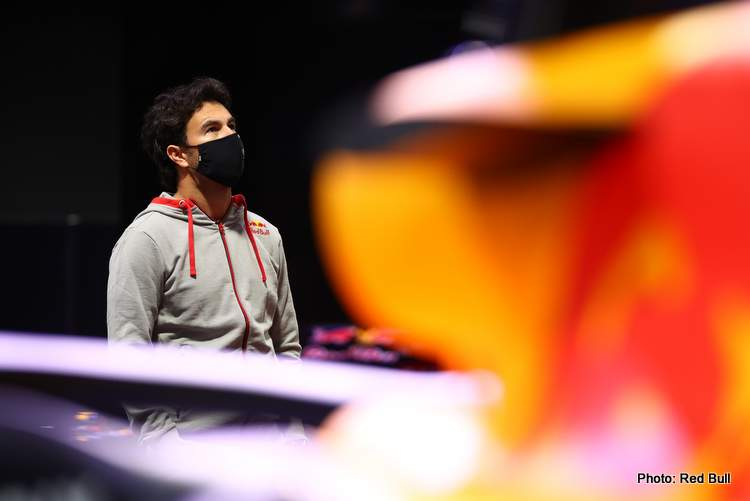 MILTON KEYNES, ENGLAND - JANUARY 11: Sergio Perez of Mexico and Red Bull Racing looks at the history of the team at MK-7 at Red Bull Racing Factory on January 11, 2021 in Milton Keynes, England. (Photo by Mark Thompson/Getty Images)