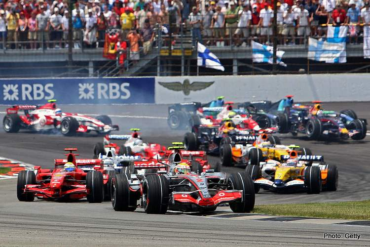 Lewis Hamilton of McLaren Mercedes races as cars crash behind him on the first lap of the F1 Grand Prix of USA at the Indianapolis
