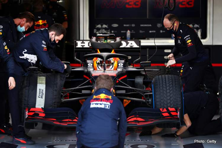 Max Verstappen prepares to drive in the garage during the Red Bull RB16B