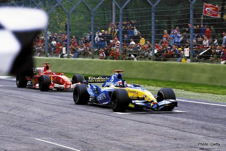 Alonso Renault-M.Schumacher-Ferrari-San-Marino-GP-Imola-F1-2005-finish-line=bridgestone