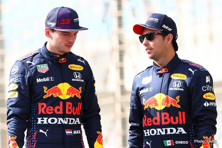 Max Verstappen of Netherlands and Red Bull Racing and team mate Sergio Perez of Mexico