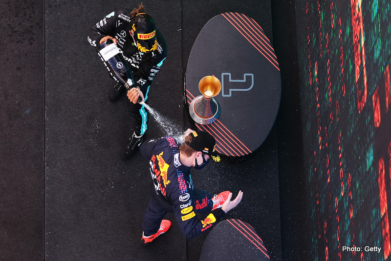 BARCELONA, SPAIN - MAY 09: Spanish grand Prix Race winner Lewis Hamilton of Great Britain and Mercedes GP and second placed Max Verstappen of Netherlands and Red Bull Racing celebrate with sparkling wine on the podium during the F1 Grand Prix of Spain at Circuit de Barcelona-Catalunya on May 09, 2021 in Barcelona, Spain. (Photo by Lars Baron/Getty Images) // Getty Images / Red Bull Content Pool // SI202105091049 // Usage for editorial use only //