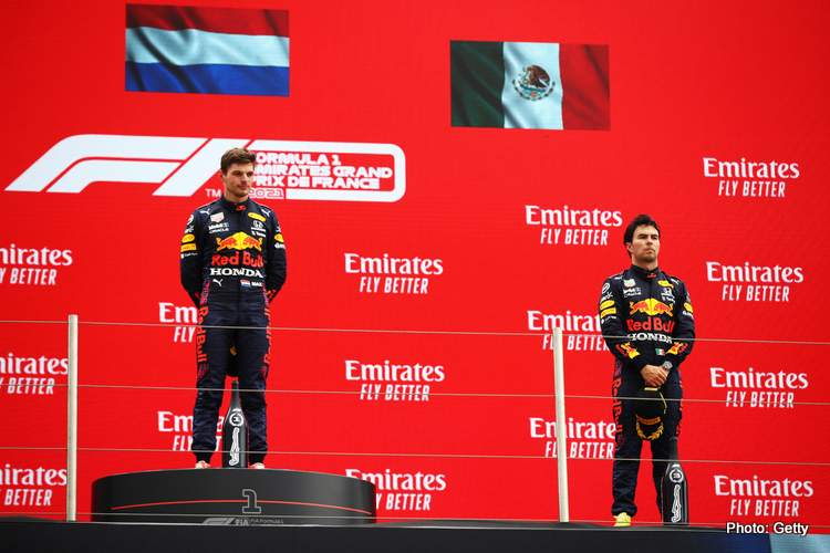 LE CASTELLET, FRANCE - JUNE 20: Race winner Max Verstappen of Netherlands and Red Bull Racing and third placed Sergio Perez of Mexico and Red Bull Racing stand on the podium during the F1 Grand Prix of France at Circuit Paul Ricard on June 20, 2021 in Le Castellet, France. (Photo by Mark Thompson/Getty Images)