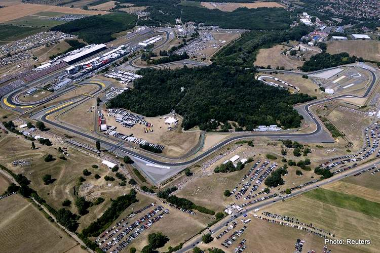 An aerial view shows the Hungaroring circuit before the Hungarian F1 Grand Prix in Mogyorod, near Budapest July 28, 2013. REUTERS/ORFK-National Police Headquater/Sandor H Szabo/Handout via Reuters (HUNGARY - Tags: SPORT MOTORSPORT F1) NO SALES. NO ARCHIVES. FOR EDITORIAL USE ONLY. NOT FOR SALE FOR MARKETING OR ADVERTISING CAMPAIGNS. THIS IMAGE HAS BEEN SUPPLIED BY A THIRD PARTY. IT IS DISTRIBUTED, EXACTLY AS RECEIVED BY REUTERS, AS A SERVICE TO CLIENTS