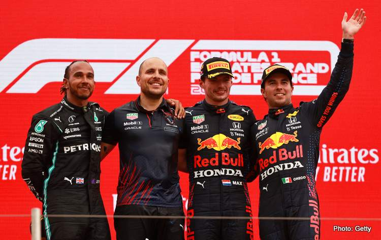 LE CASTELLET, FRANCE - JUNE 20: Second placed Lewis Hamilton of Great Britain and Mercedes GP, Red Bull Racing race engineer Gianpiero Lambiase, race winner Max Verstappen of Netherlands and Red Bull Racing and third placed Sergio Perez of Mexico and Red Bull Racing celebrate on the podium during the F1 Grand Prix of France at Circuit Paul Ricard on June 20, 2021 in Le Castellet, France. (Photo by Mark Thompson/Getty Images)