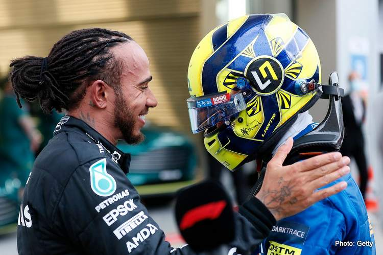 SOCHI, RUSSIA - SEPTEMBER 26: Race winner Lewis Hamilton of Great Britain and Mercedes GP hugs Lando Norris of Great Britain and McLaren F1 in parc ferme during the F1 Grand Prix of Russia at Sochi Autodrom on September 26, 2021 in Sochi, Russia Seidl . (Photo by Yuri Kochetkov - Pool/Getty Images)